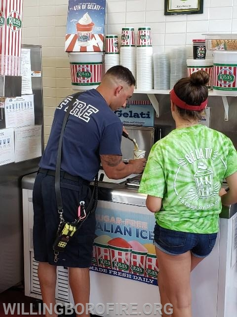 Firefighter Centrone scooping water ice